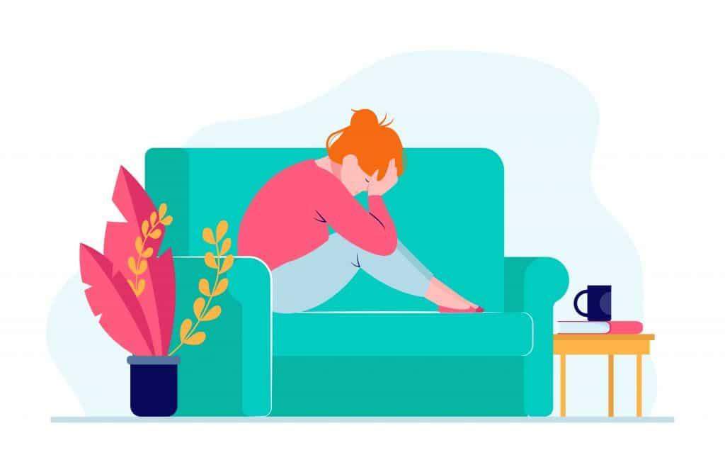 Illustrazione di donna sul divano che sta avendo attacco di panico